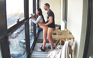 Busty Teen in Hot Smoking Action mainly the Balcony